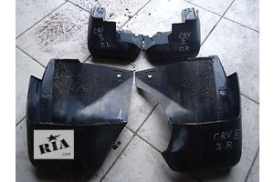 б/в Бризковики і підкрилки Honda CR-V
