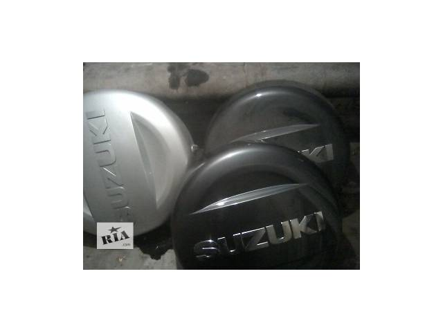 бу Б/у чехол запасного колеса для кроссовера Suzuki Grand Vitara (3d) в Львове