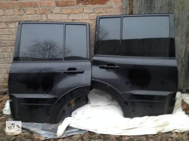 купить бу Б/у дверь задняя для легкового авто Mitsubishi Pajero Wagon КОМПЛЕКТНЫЕ  в Киеве