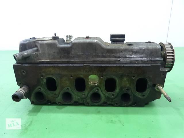 продам Б/у головка блока для легкового авто Ford Focus 1.8 F9DA1D  бу в Яворове (Львовской обл.)