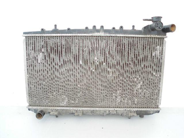 продам Б/у радиатор для легкового авто Nissan Primera 2.0D P10 (67-34). бу в Буче (Киевской обл.)