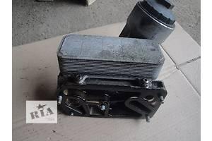 б/у Корпуса масляного фильтра Volkswagen T5 (Transporter)