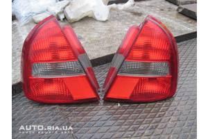 Фонари задние Mitsubishi Carisma