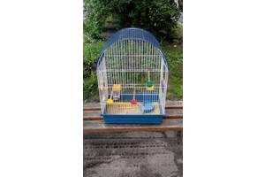 Клітка для папуги і любо кого