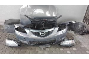 Бамперы передние Mazda