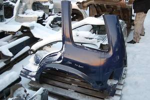 чверті автомобіля Kia Sportage