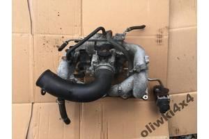 б/в колектори впускні Suzuki Jimny