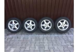 б/у диски с шинами Opel Astra