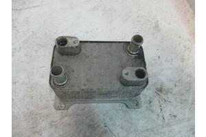 Масляний радіатор коробки передач Passat B6 пасат б6