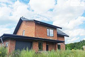 Продается дом на 2 этажа 200 кв. м с гаражом