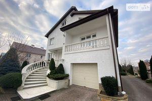 Продается дом на 3 этажа 320 кв. м с участком