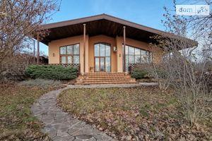 Продається одноповерховий будинок 390 кв. м з каміном